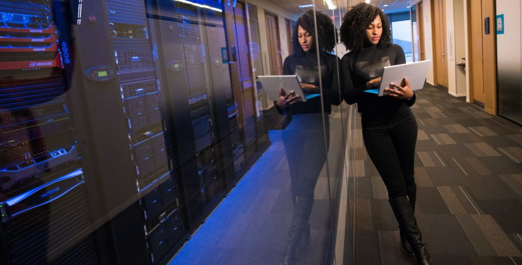 Woman standing next to a server