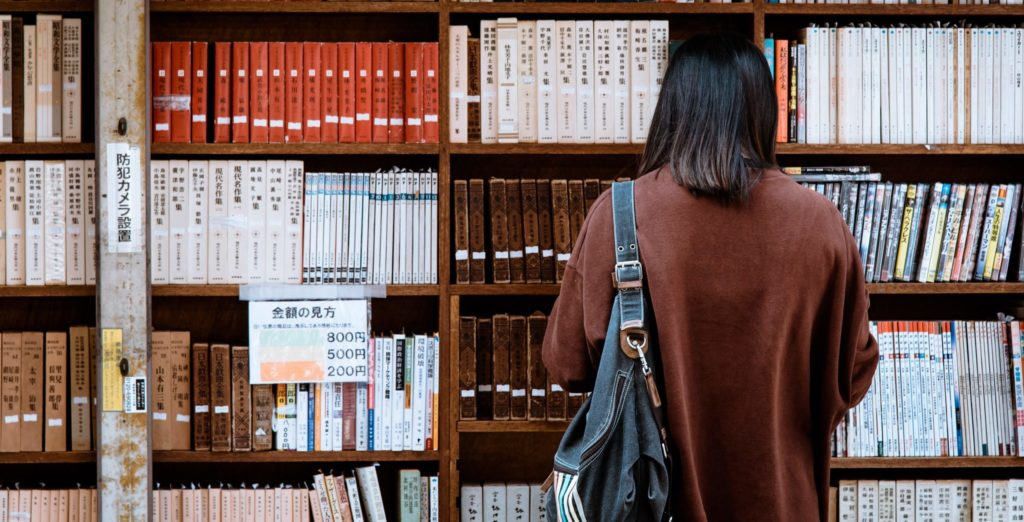 Woman Standing in a Library